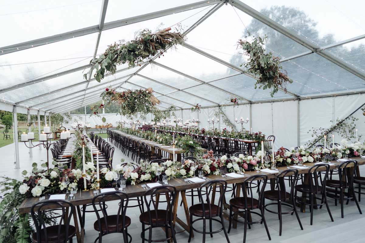 Clear marquee with hanging floral and extensive table decoration