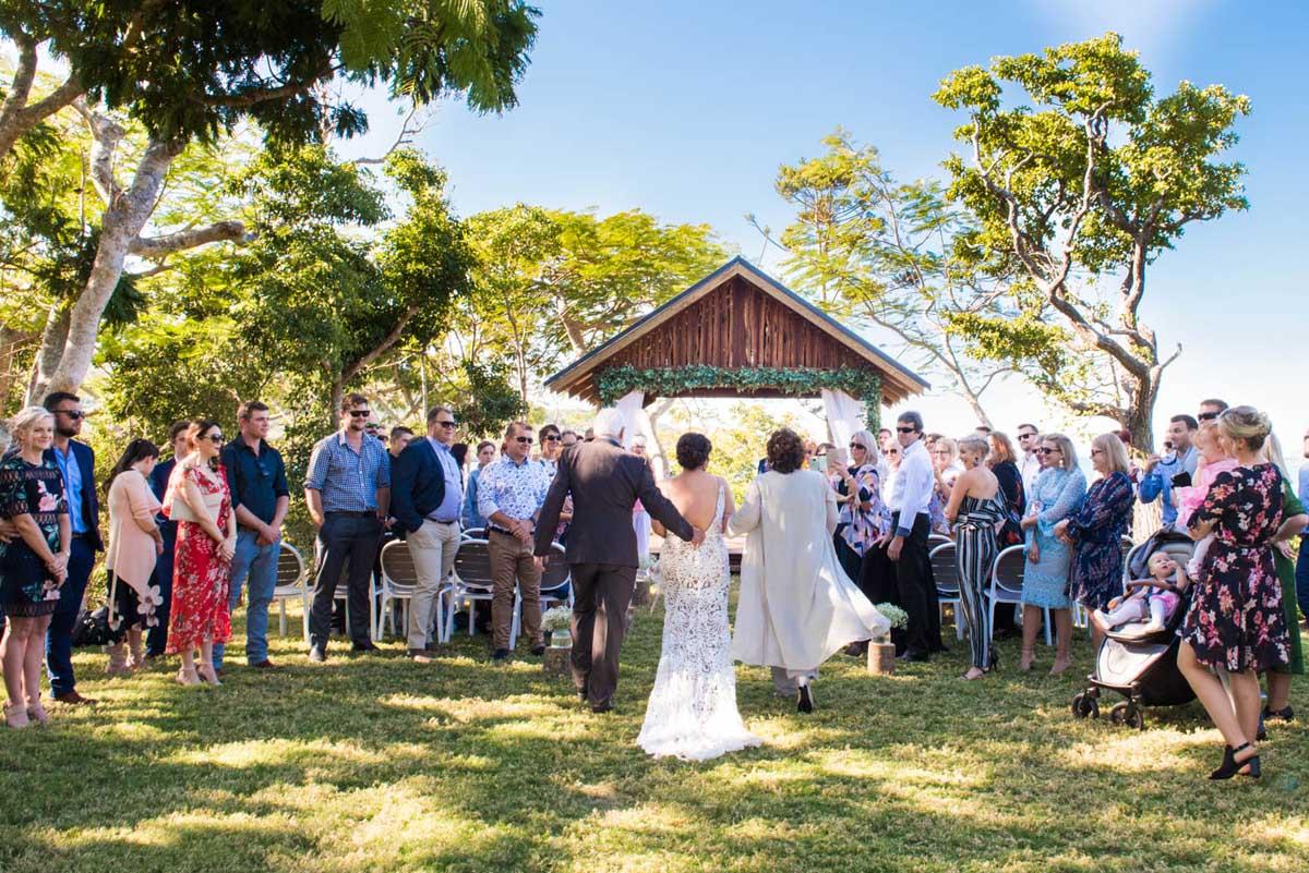Parents walking bride down the aisle at Earlando