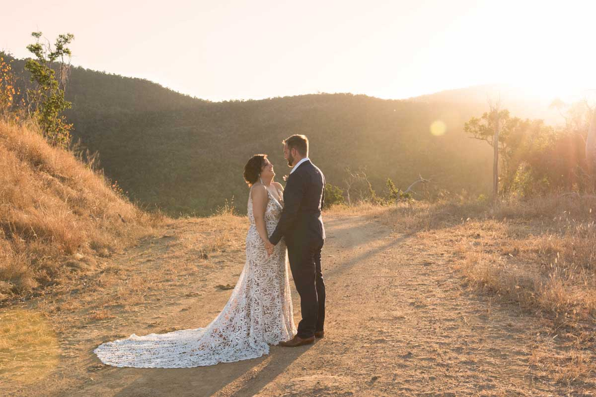 Bride and groom at sunset on a hill at Earlando